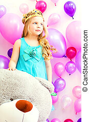 Studio shot of cute girl posing with teddy bear - Studio...