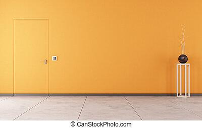 Empty orange room with door
