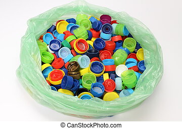 Bottle Cap - Multicolored bottle caps for recycling in a...