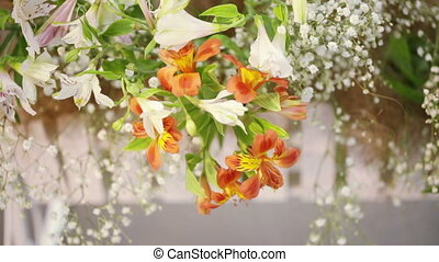 Flowers in decorative basket - Various flowers in white...