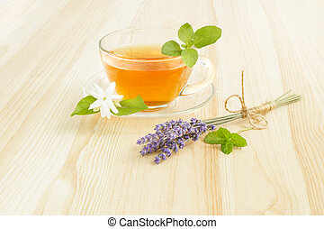 Cup tea with mint. - Cup tea with mint over wooden table.