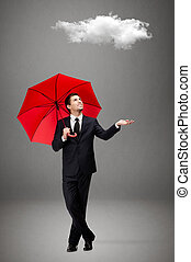 Man with red umbrella checks the rain - Palming up man with...