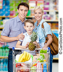 Half-length portrait of family in the store