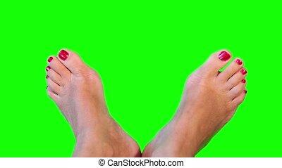 Feet closeup. Green screen.