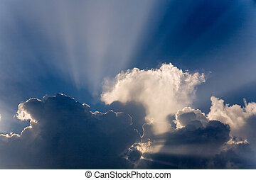 Clouds in sky with sunrays on sunrise