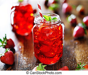 vivid red strawberry cocktail in a jar