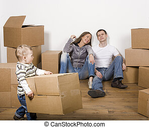 stock-photo-smiling -family-in-new-hous e-playing-with-boxe...