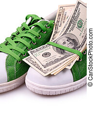 Paper Currency on a green shoes, isolated