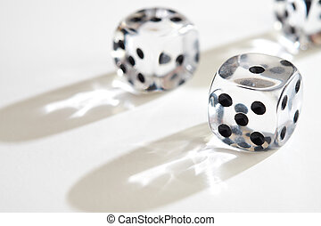 Coloured Dice - Transparent dice on a white background.