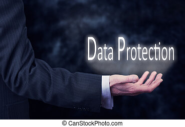 Data Protection - A businessmans hand holding the words,...