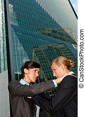 Businesswomen Fighting - Two attractive businesswomen...