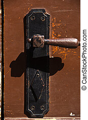 Door handle - Detail of an old wooden door