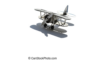 Old Biplane - Metal miniature model of old biplane isolated...