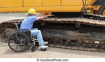 disabled maintenance mechanic working on the tracks of a...