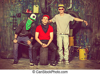 ballet garage - Group of cool guys hang out in the garage....
