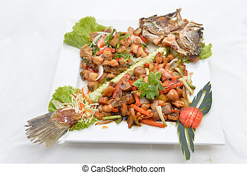 Thai food fried fish with spicy sauce isolated in white backgrou