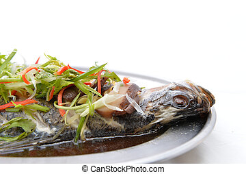 Snapper fish with soy sauce is steamed