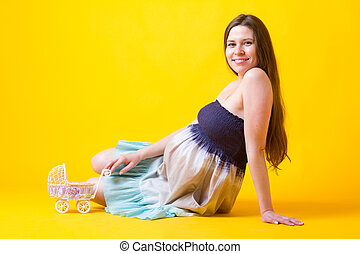 Pregnant woman with petite buggy