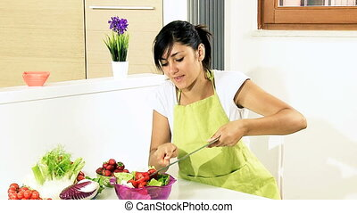 Woman preparing healthy salad - Beautiful happy girl...