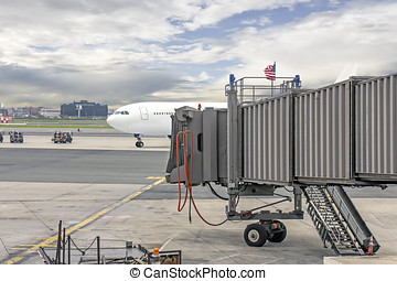 Passenger plane parked at jetway - Commercial airport. Front...