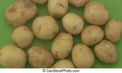 Potatoes a green  background