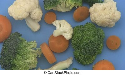 Mixed vegetables on a blue backgrou - Close up of mixed...