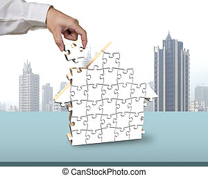 assembling blank white puzzles in house shape