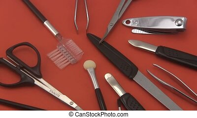 Manicure set on a red background - Close up of a manicure or...