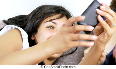 Happy women play with phone