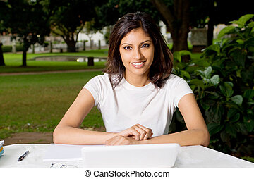 pretty exchange student - pretty indian woman in park at...