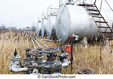 Old rusty pipes, valves and tanks