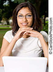 confident student - confident indian using laptop with...