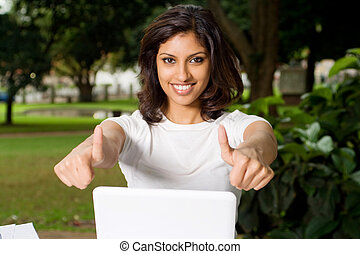 happy student with laptop - woman giving thumbs up signal...