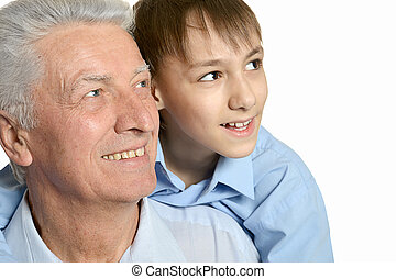 Grandfather and grandson embracing on white background