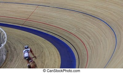 Cycling track race turn rear view