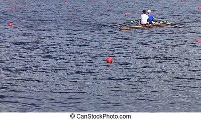 Sculling Two men rowing tracking sh
