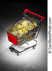 shopping cart full of money on dark background