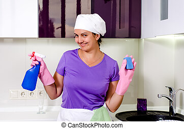 Cute happy playful housewife wearing a white cap over her...