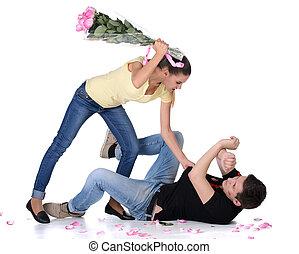 Jealousy - Jealous young woman beat her boyfriend bouquet of...