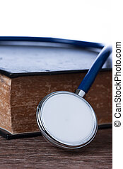 Education concept , Stethoscope on old book.