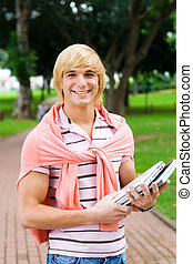 happy uni student - a happy, smiling student in park with...
