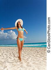 Young woman in bikini on the beach