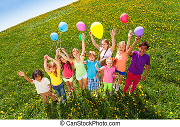 View from top of standing children with balloons