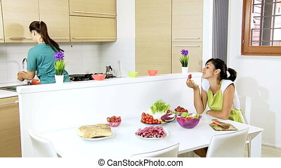 Women preparing healthy food - Two women at home preparing...