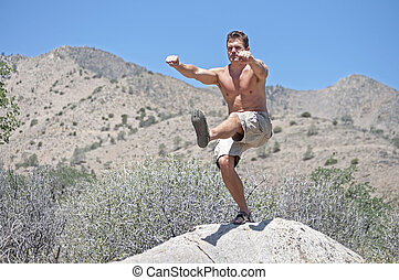 One-legged air squat - Muscular shirtless Caucasian man...