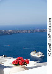 view of volcanic islands of santorini with cruise ship -...
