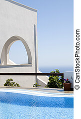 greek island architecture with pool and sea view - greek...