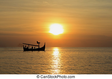 Balinese Fishing Boat at Sunset - A Balinese fishing boat...