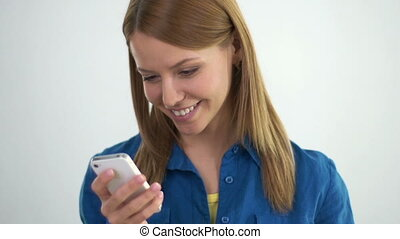 Bursting with Joy - Close up of cute lady texting joyfully...