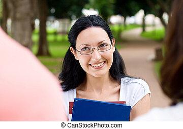lovely freshman - freshman beauty talking to friends in park